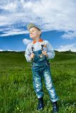 Little farmer. In a meadow under blue sky Royalty Free Stock Images