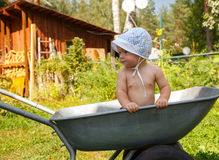 Little farmer and his wheelbarrow Stock Photos
