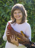 little farmer is holding a rooster Stock Photo