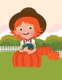 Little farmer of pumpkins Royalty Free Stock Image