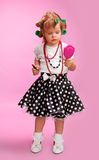 Little fashion-conscious girl, just like mother. Using  lipstick, mirror, rollers and others Stock Photography