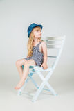 Little fashion girl in beautiful dress posing Stock Photo