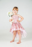 Little fashion girl in beautiful dress posing Royalty Free Stock Photo
