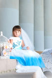 Little fashion-girl in magnificent blue and white evening dress Royalty Free Stock Photos