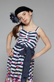 Little fashion girl posing with hands on hips Stock Photo