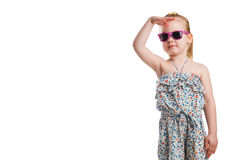 Little fashion girl in sunglasses isolated on white background Royalty Free Stock Images
