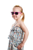 Little fashion girl in sunglasses isolated on white background Royalty Free Stock Photo
