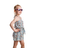 Little fashion girl in sunglasses isolated on white background Royalty Free Stock Photography