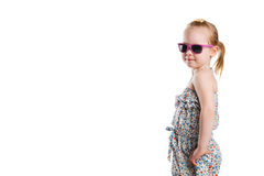 Little fashion girl in sunglasses isolated on white background Royalty Free Stock Image