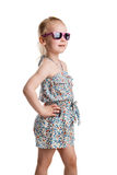Little fashion girl in sunglasses isolated on white background Stock Photos