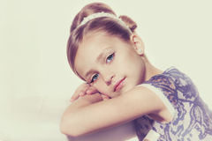 Little fashion kid girl. Portrait of a little fashion kid girl stock photo