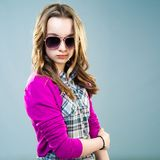 Little fashion model in sunglasses Stock Photo