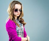 Little fashion model in sunglasses Royalty Free Stock Image