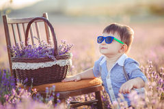 Little fashionable boy having fun in lavender summer field. Stock Photography