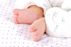 Little feet of baby Stock Photography