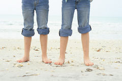 Little feet in the sand at the beach Royalty Free Stock Images