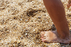 Little feet on the shore Royalty Free Stock Photos