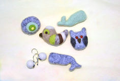 Little Felt Animals. Hand Made from Wool Felt Animals on a hand painted watercolour background Royalty Free Stock Photos
