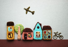 Little felted houses, bicycle, tree Royalty Free Stock Photography