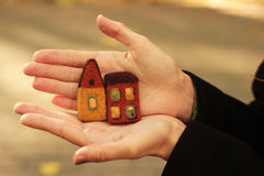Little felted houses. In girl's arms Royalty Free Stock Photography