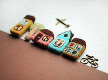 Little felted houses, tree, bicycle Stock Photography