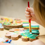 Little female baby painting with colorful paints Stock Photography