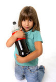 Little female child holding big cola soda bottle looking vulnerable in children sugar addiction Royalty Free Stock Photo