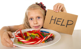 Little female child nutrition abuse of sweet and sugar in candy unhealthy food Royalty Free Stock Image