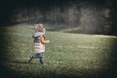 Running child on lawn Royalty Free Stock Photo