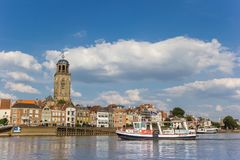 Little ferry crossing the IJssel river to historic city Devente royalty free stock photos