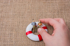 Little figurine men in a life preserver Royalty Free Stock Photography