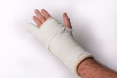 Little finger in cast. Little finger/Arm/Wrist in cast on a white background, studio isolated Royalty Free Stock Images
