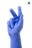 Little Finger Spelling the Alphabet in American Sign Language (ASL). The Letter K stock image