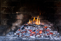 Little fire burning in fireplace Royalty Free Stock Photo