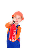 Little firefighter. Little boy plays with a fire extinguisher Firefighter stock photos