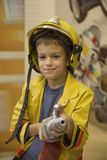 Little firefighter. Cute little boy dressed as firefighter Stock Photo