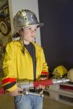 Little firefighter Stock Images