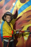Little firefighter Stock Image