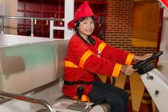 Little firefighter royalty free stock photography