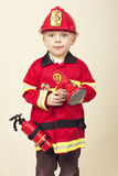 Little Fireman. A cute little boy dressed up in a fireman costume Royalty Free Stock Images