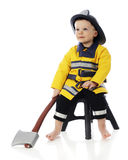 Little Fireman and His Hatchet Stock Image