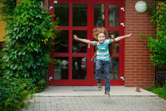 Little first grader rejoices to the beginning of summer vacation. Stock Photography