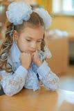Little first grader sad Stock Images
