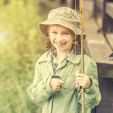 Little fisher girl smiling Royalty Free Stock Images