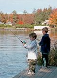 Little Fishermen. Two brothers fishing off a dock on a mountian lake Stock Images