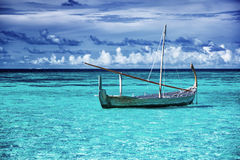 Little fishing boat in blue sea Royalty Free Stock Photo