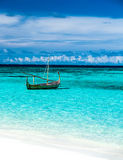 Little fishing boat in blue sea Stock Photo