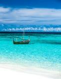 Little fishing boat in blue sea Stock Photo