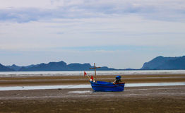 Little Fishing boat and blue sky. In thailand Royalty Free Stock Photo