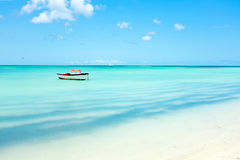 Little fishing boat in the caribbean sea on Aruba island. In the Caribbean royalty free stock image